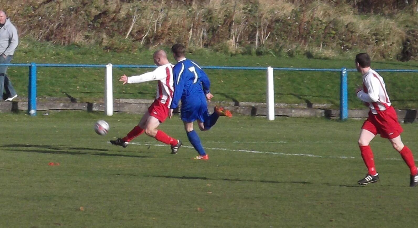 Thistle's defender Mark Russell clears the ball