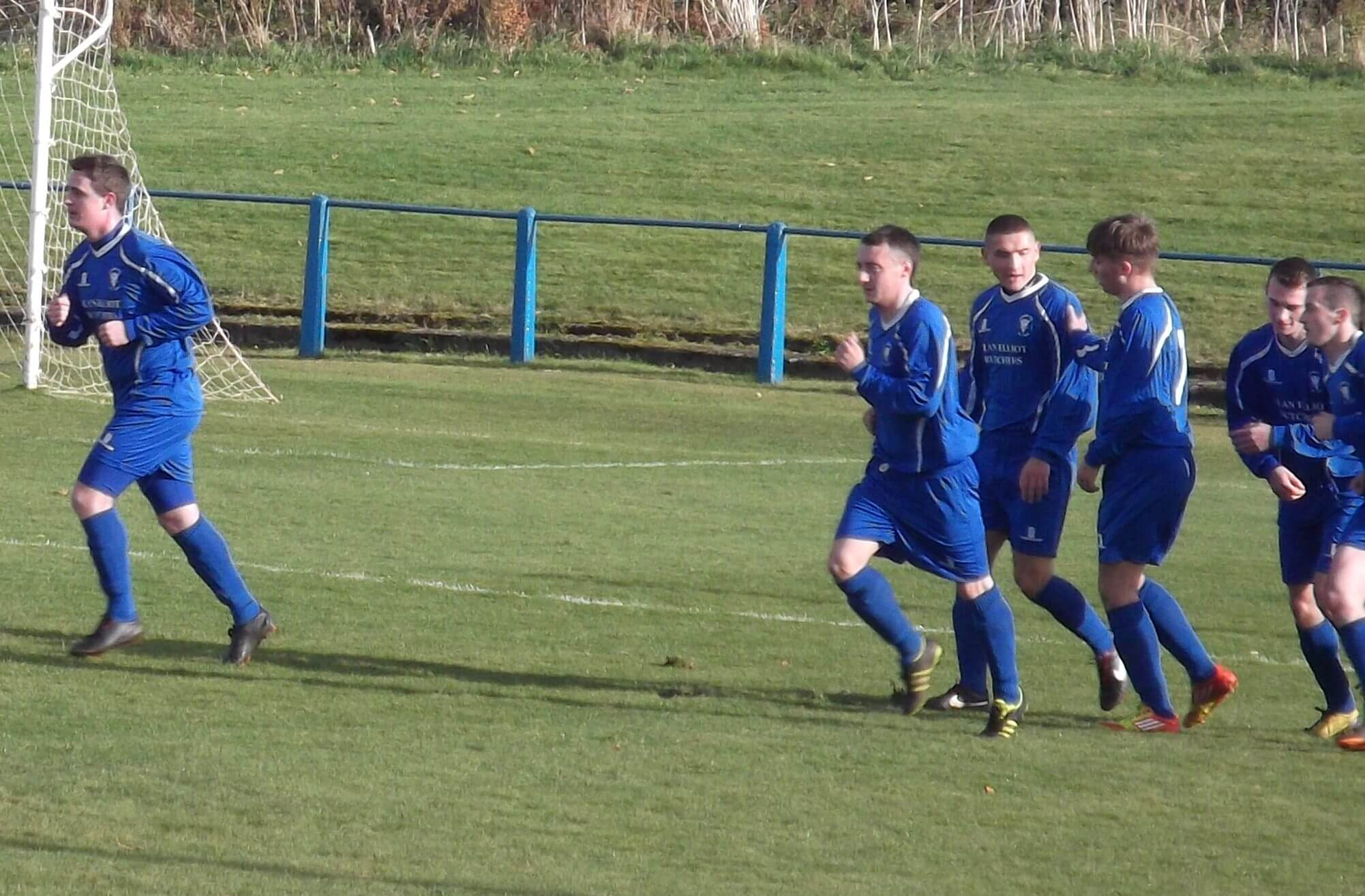 Lanark players celebrate the first goal against Larkhall Thistle