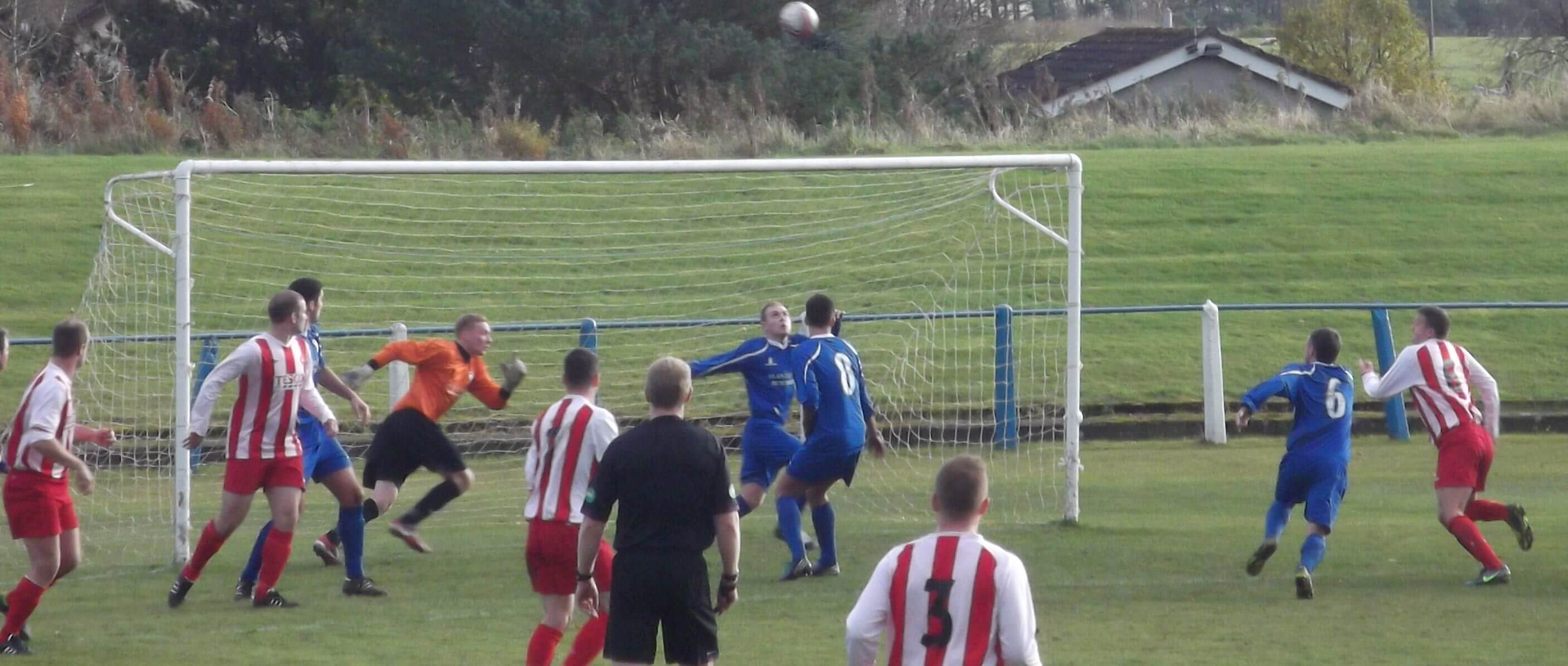 The Lanark keeper scrambles across to repel another Larkhall Thistle attack