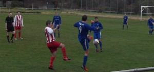 Larkhall Thistle's JP Grant in a challenge against Dunipace