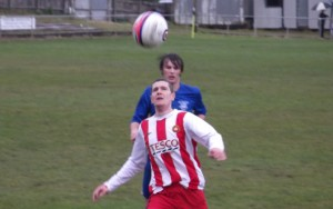 Larkhall Thistle's new signing Brian Jack challenges for the ball