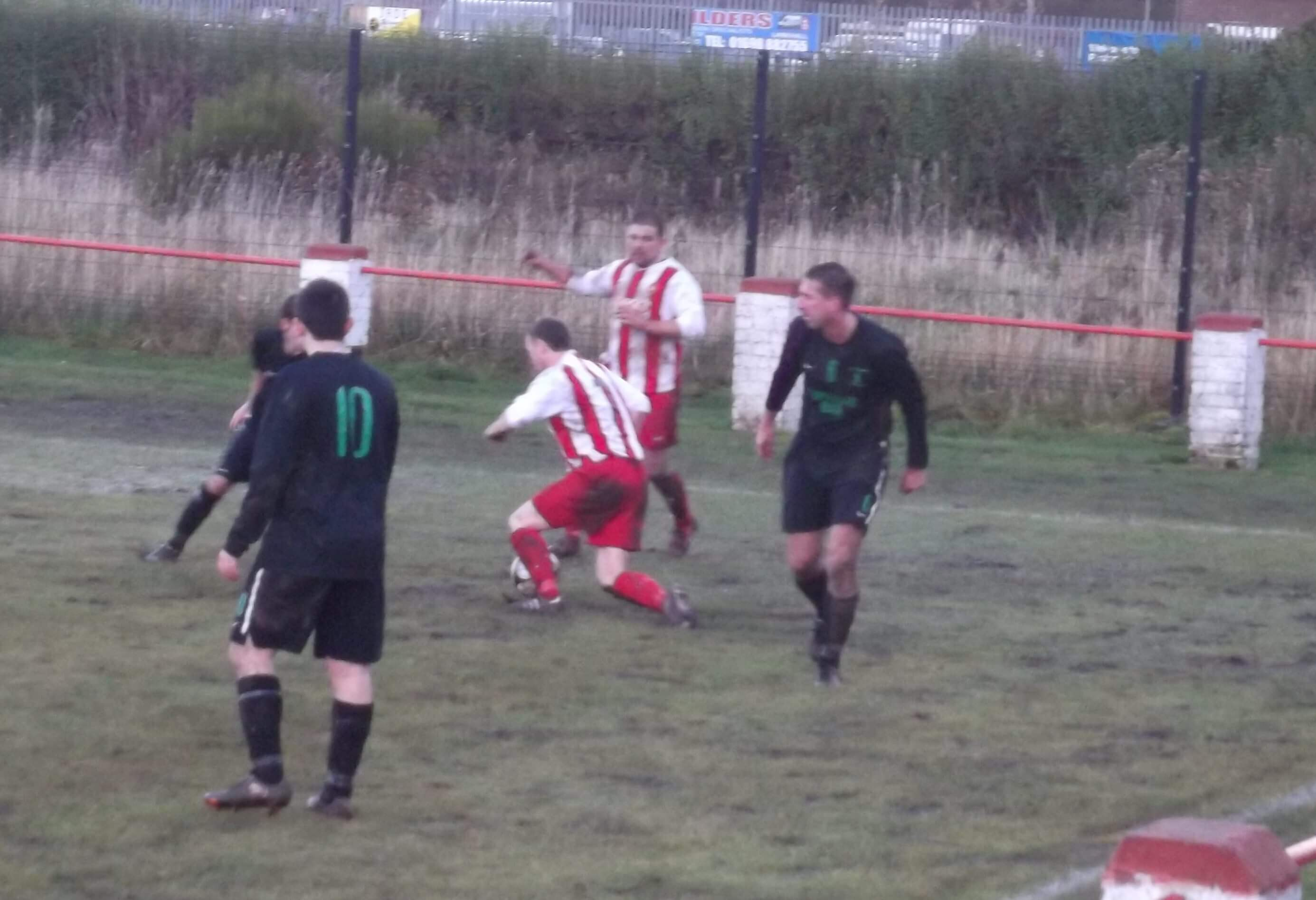 Larkhall Thistle v St Roch's 3 - Jags' Brian Jack jinks in to the box watched by JP Grant