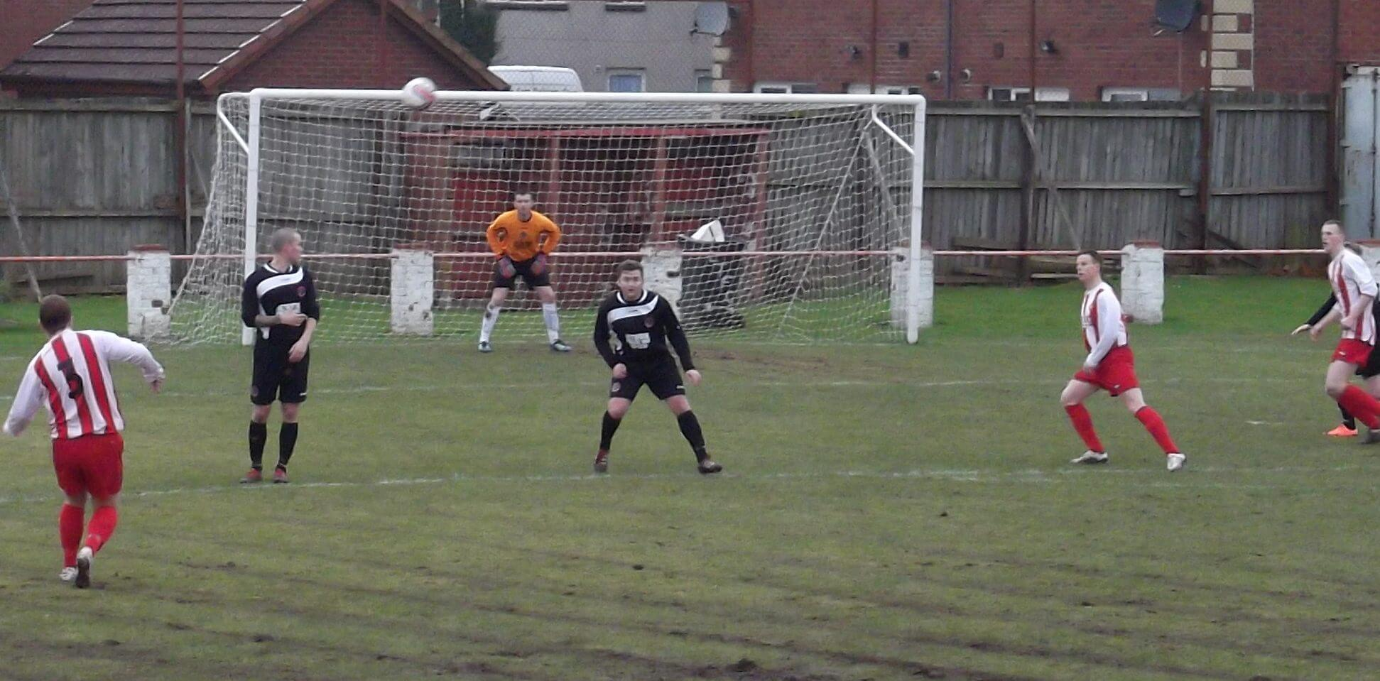 Mark McKeever and Graham Gracie watch Dean Richardson's cross
