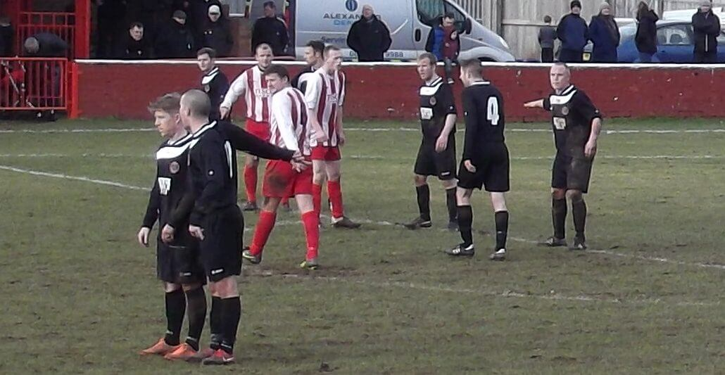 Thistle's Mark Canning, Graham Gracie and Alan Fleming take their places for a Jags free kick
