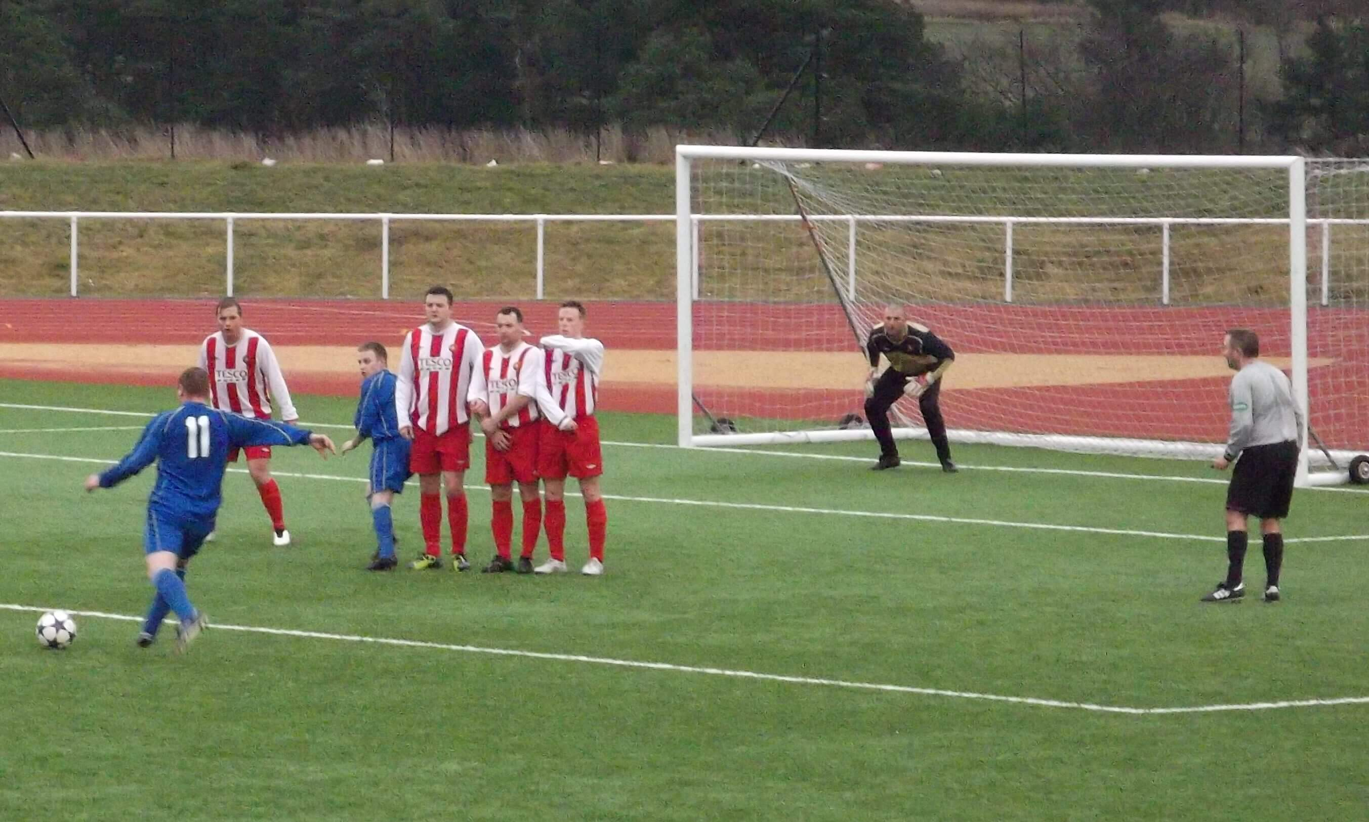 Carluke line up a free kick in the second half