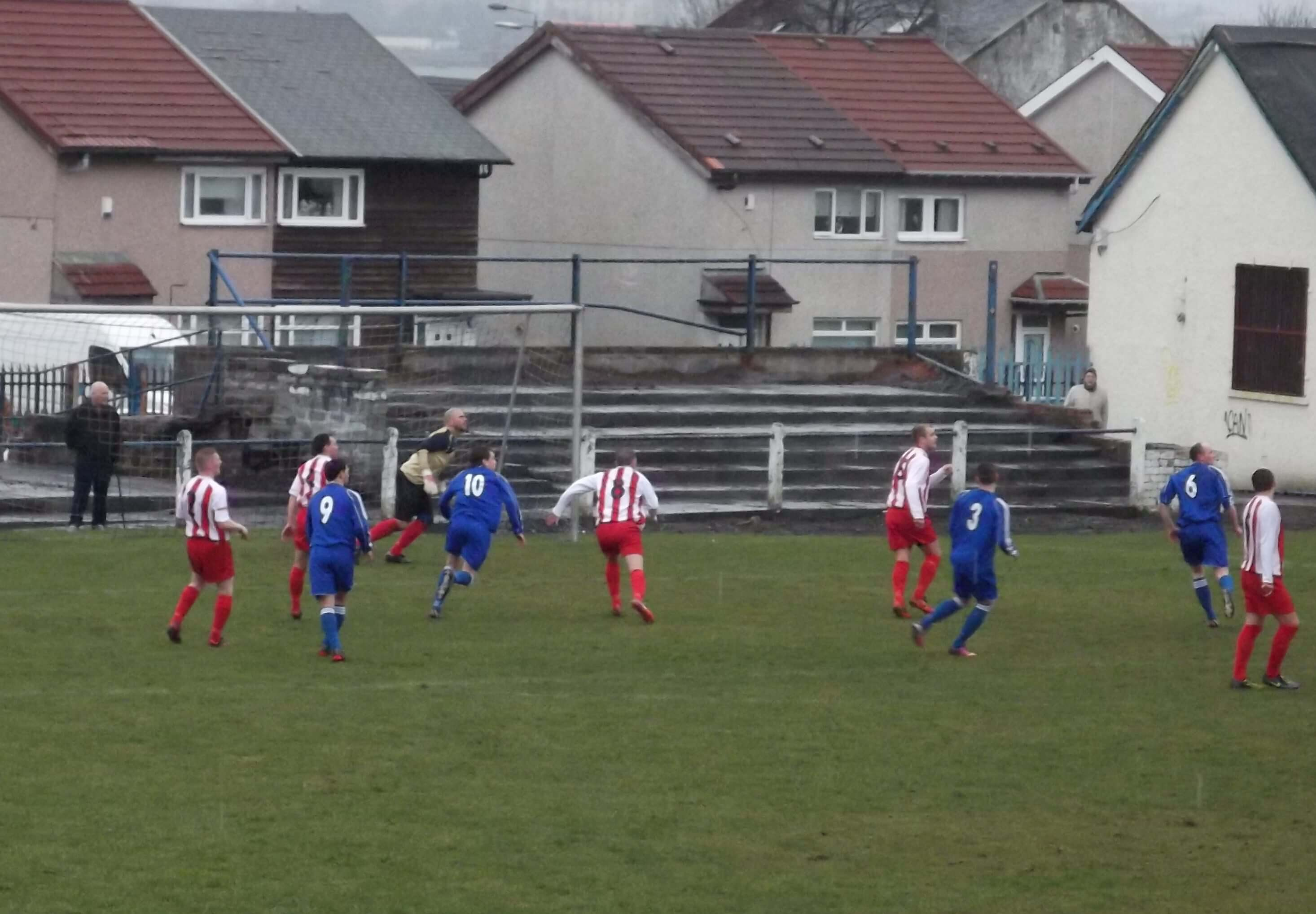 Thistle defend a cross ball at Benburb