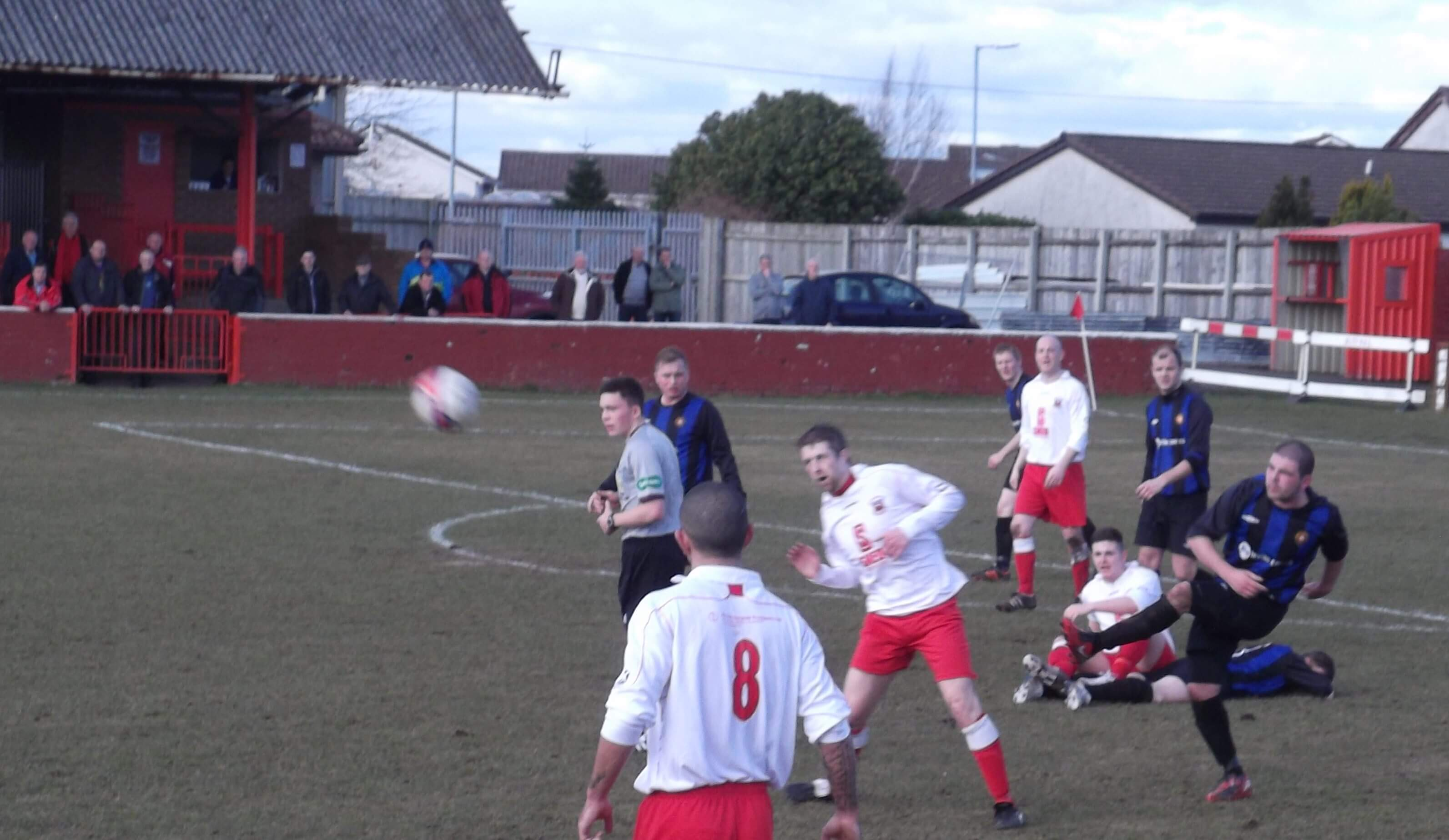 JP Grant clears for Larkhall Thistle as Fleming and Kelly look on