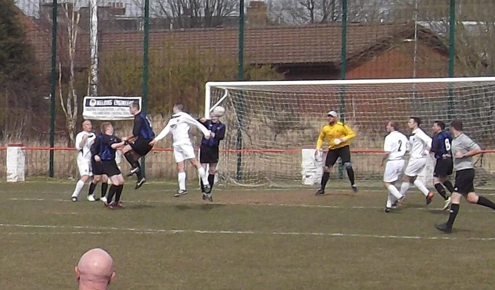 Thistle clear a Shettleston free kick