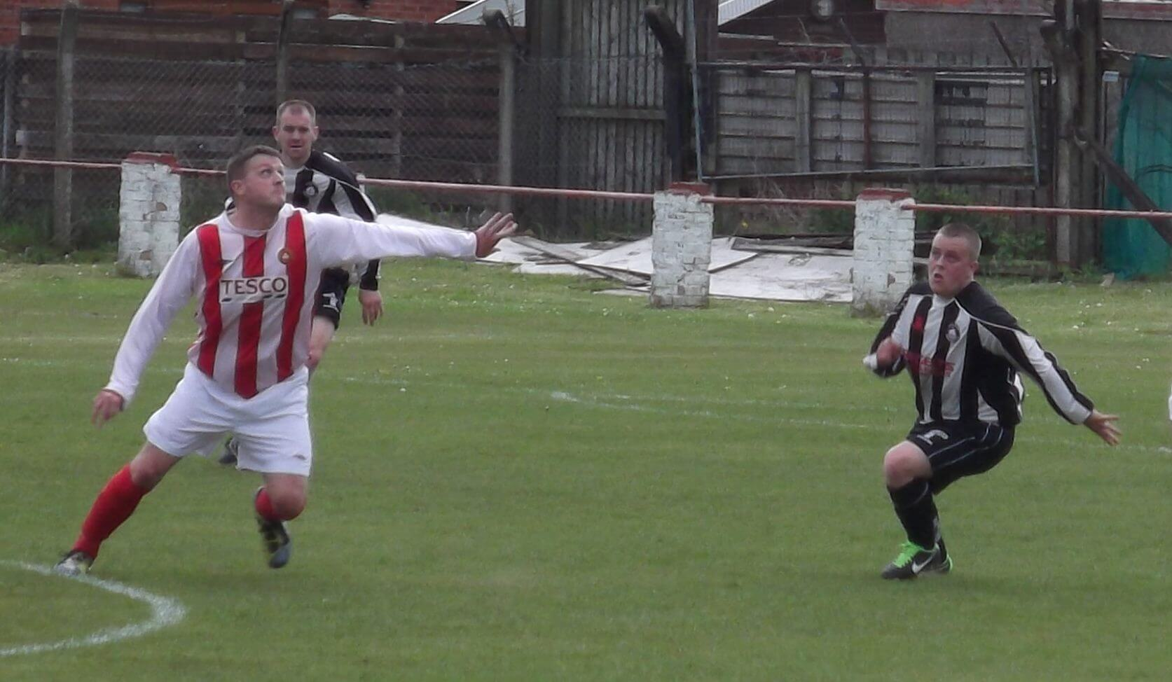 Mark Canning challenges for a ball in midfield