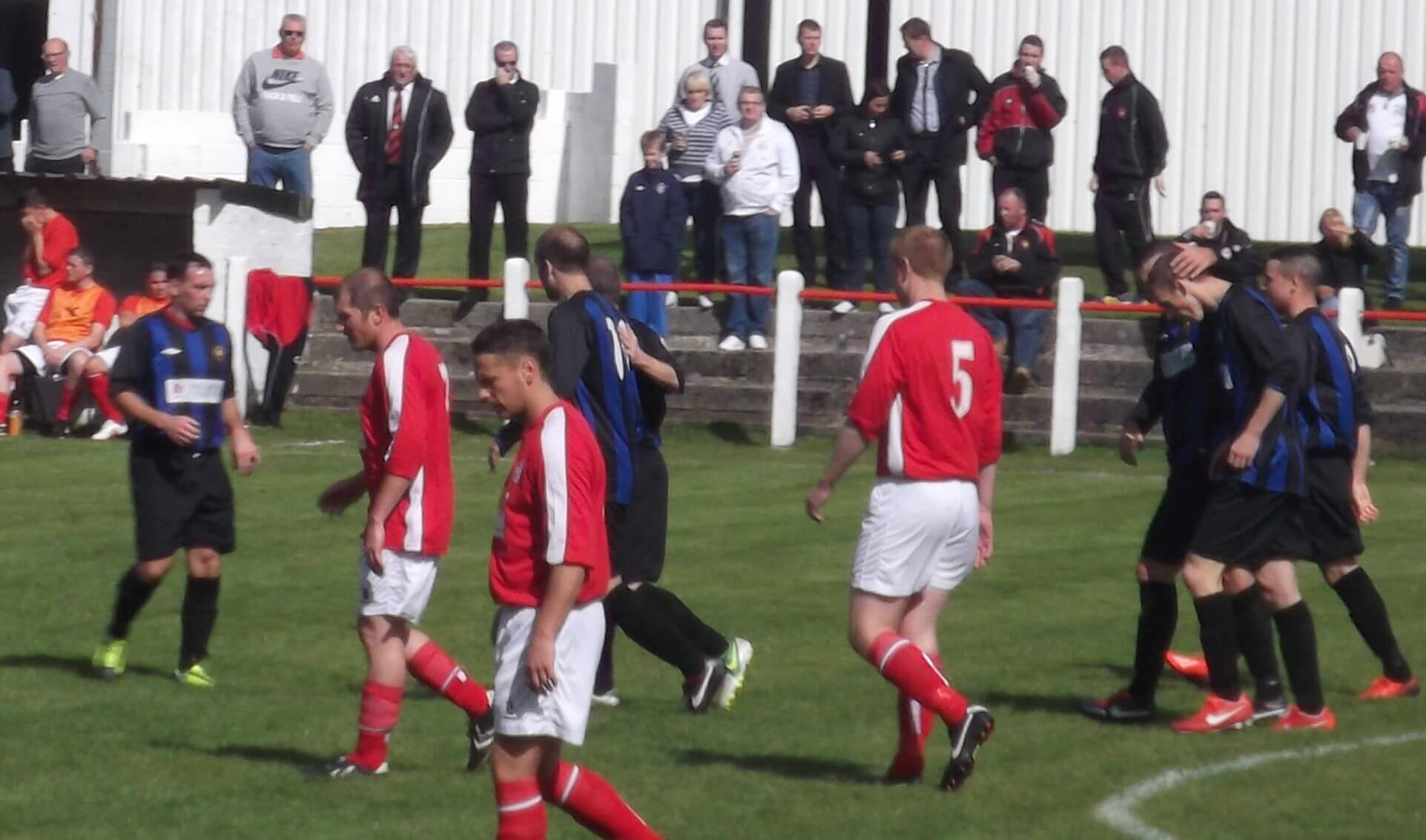 Larkhall Thistle players congratulate goal scorer Graham Gracie