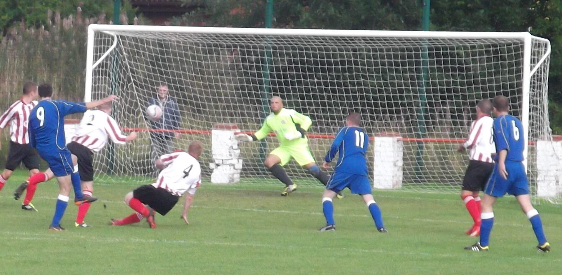 Davie McEwan dives to produce wonder save