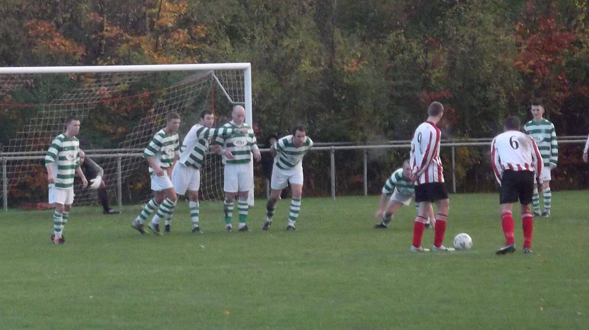 Canning lines up effort from free kick