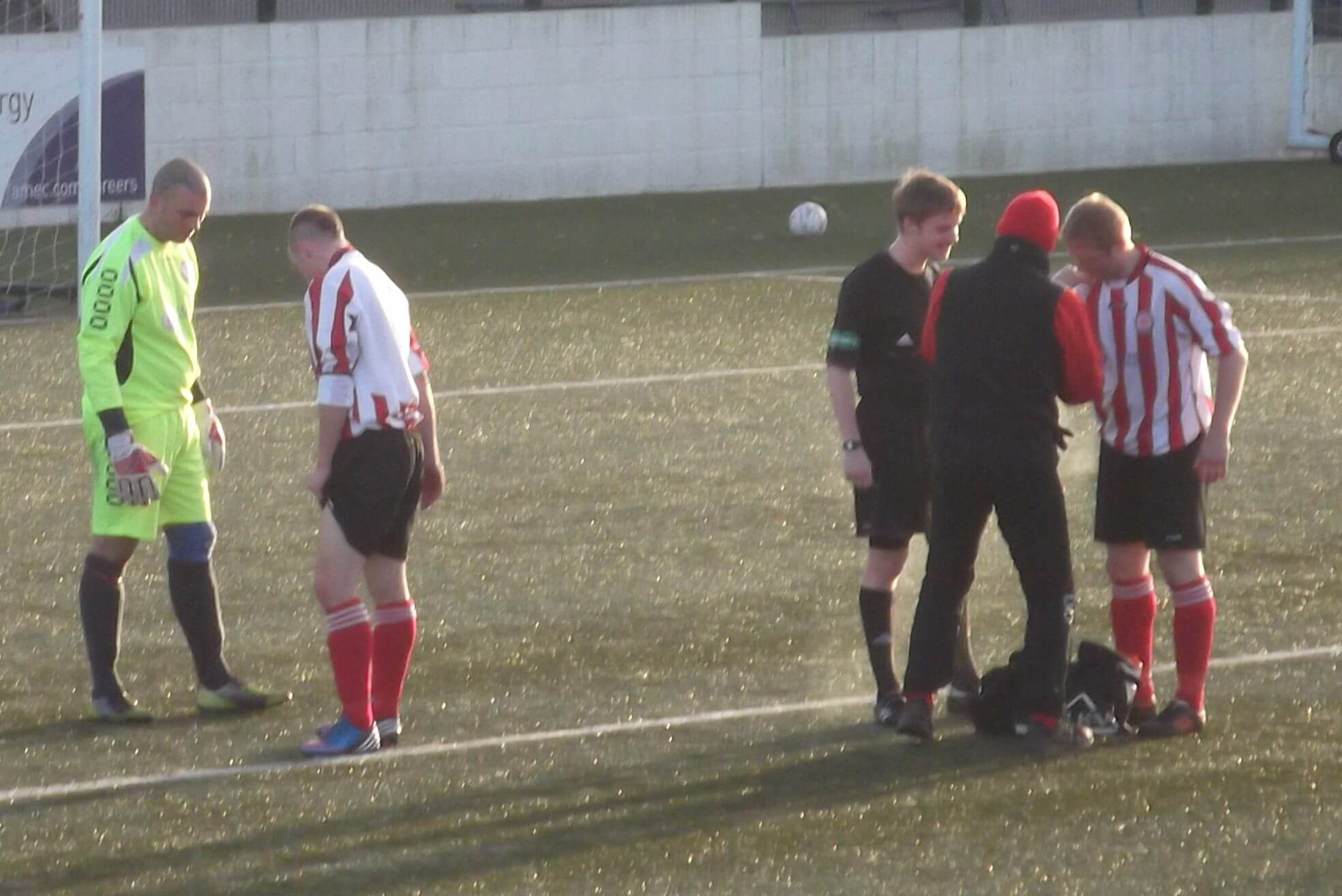 Ryan Innes shows Davie McEwan his injury as Andy Brown gets treatment