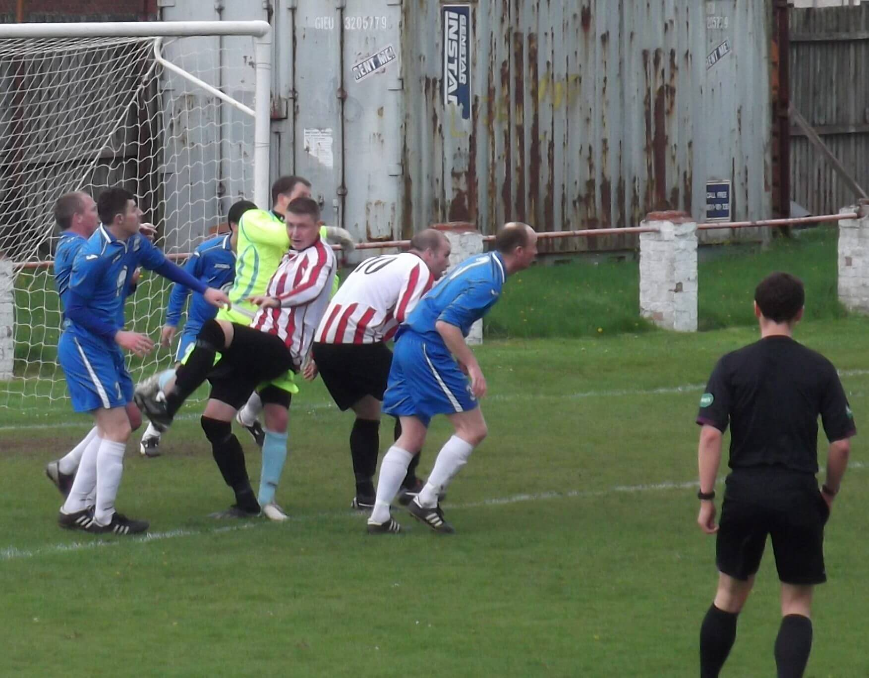 Thistle's Neil Schoneville gets taken out by the Bens keeper.