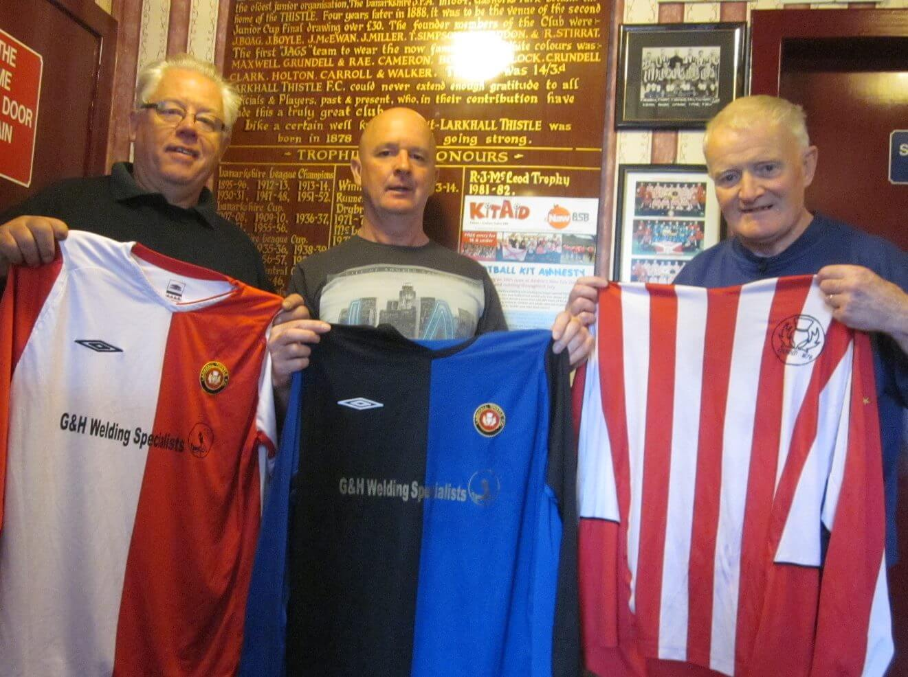 Thistle president Chres Lenson and treasurer Hugh Kerr with Robert Cox from Airdrie Trust Kit Amnesty