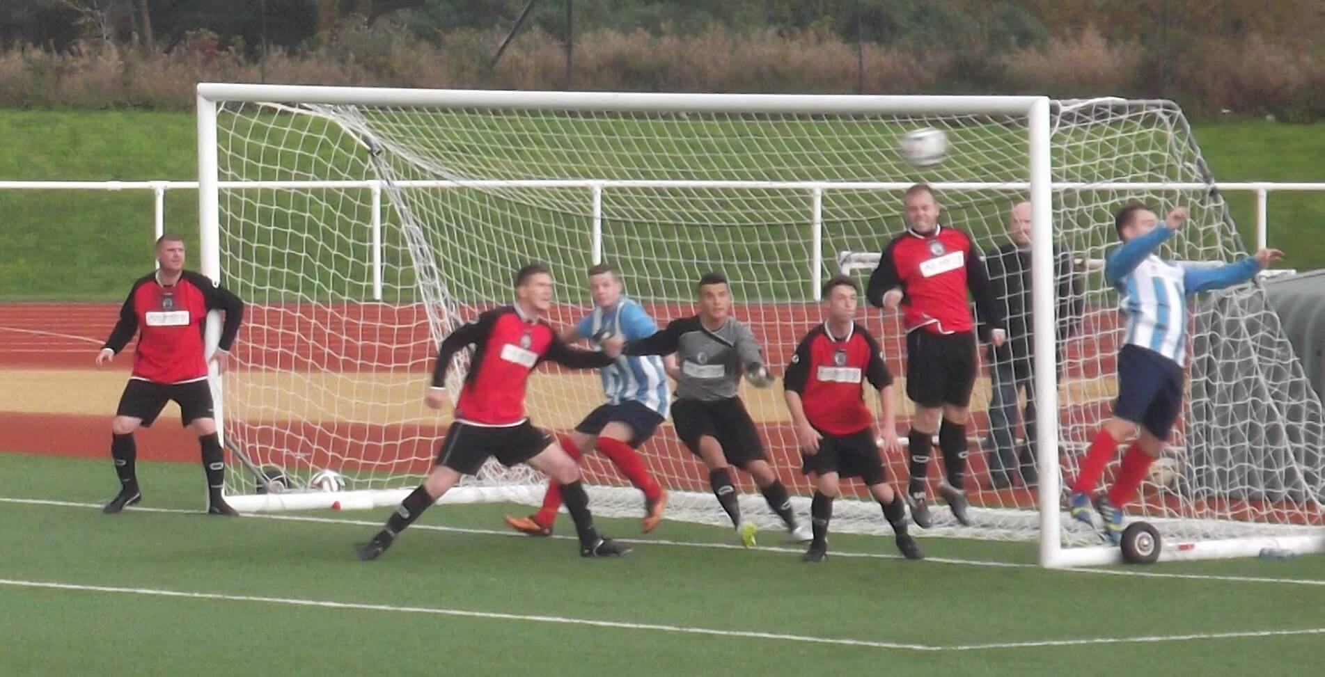 Carluke defender clears off the line